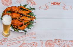 Seafood menu design, centre spread. Hand drawn illustration, lemon, shrimps, fork and knife, dried fish, glass of beer. Boiled red crawfish on a plate with Stock Photography
