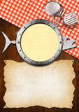 Seafood Menu with Metal Porthole. Restaurant seafood menu with metal porthole, empty parchment and kitchen utensils on wooden wall and table cloth Stock Photography