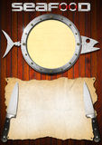 Seafood Menu with Metal Porthole. Restaurant seafood menu with metal porthole, empty parchment and two kitchen knives on wooden wall Stock Images