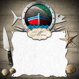 Seafood Menu with Metal Porthole. Template for a seafood menu with metal porthole in the shape of a fish, label and white empty sheet of paper on a wooden wall Stock Images