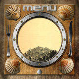 Seafood - Menu Template. Metal porthole with yellow lined paper, fishing net, scallop shells and silver cutlery. Template for recipes or seafood menu Stock Photography