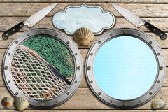 Seafood - Menu Template. Two metal portholes with fishing net, kitchen knife, empty label and seashells, template for recipes or seafood menu Stock Images