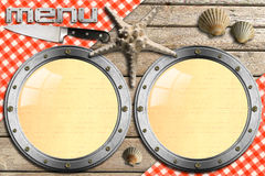 Seafood - Menu Template. Two metal portholes, kitchen knife and red checked tablecloth, seashells and starfish, template for recipes or seafood menu Royalty Free Stock Photography