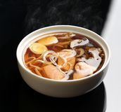 Seafood miso soup with salmon calamary and mashrooms. Seafood miso soup with salmon calamary  quail egg and mashrooms in white plate on a black background Royalty Free Stock Photos