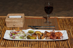 Seafood mix barbecue with salad on plate on bamboo table Royalty Free Stock Images