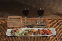 Seafood mix barbecue with salad on plate on bamboo table Royalty Free Stock Photo
