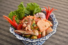 Seafood mix with octopus and herbs in bowl Royalty Free Stock Images