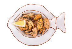 Seafood-mussels. Cooked with herbs and decorated with lemon on a white plate isolated Stock Photography