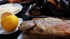 Seafood Mussels and Fish Trout on a Plate in a Restaurant stock video footage