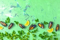 Seafood mussels with lemon and parsley, food background royalty free stock image