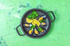Seafood mussels with lemon and parsley royalty free stock photo