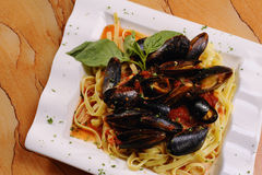 Seafood Mussels in Red Sauce Over Pasta Stock Image