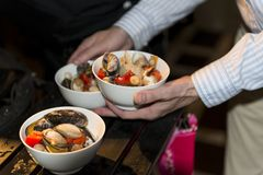 Seafood, mussels with vegetables, tomatoes and peppers in the di Royalty Free Stock Photography