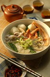 Seafood noodle. With squids, cuttlefish, shell, fish-ball, prawn & vegetable, and decorate with Chinese tea set Royalty Free Stock Image