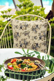 Seafood noodle in plate in garden. Seafood noodle in plate on glass table in garden stock images