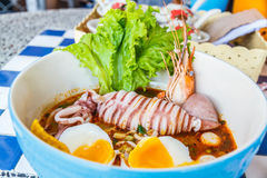 Seafood noodles spicy Stock Photo