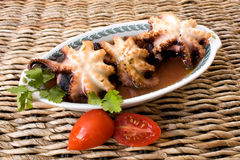 Seafood - Octopus. Food and Drinks - Italian recipes - Plate with octopus cooked in italian style Stock Photo