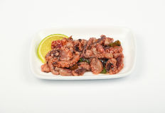 Seafood octopus salad snack on white plate Royalty Free Stock Photos