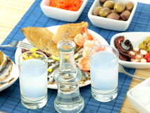 Seafood and ouzo Stock Photos