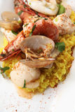 Seafood paella. Photograph of seafood paella portion with saffron rice Royalty Free Stock Images
