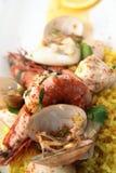 Seafood paella. Photograph of seafood paella portion with saffron rice Stock Photos