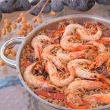 Seafood paella. Rice, vegetables, king prawns Royalty Free Stock Image