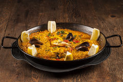 Seafood Paella. Spanish rice specialty, seafood Paella with lemon