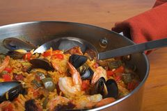 Seafood paella. Paella pan with spoon stock photos