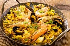 Seafood Paella. As closeup in a wrought-iron pan Stock Photo