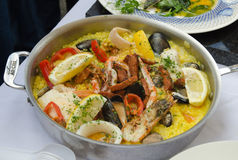 Seafood paella being cooked in a frying pan Stock Images