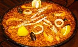 Seafood paella in black pan Stock Photos