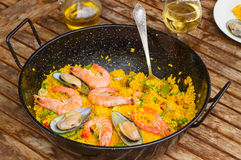 Seafood paella in black pan Stock Image