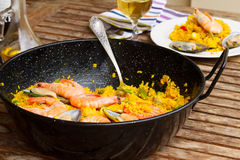 Seafood paella in black pan Stock Photos