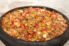 Seafood paella in a clay pan Royalty Free Stock Photography