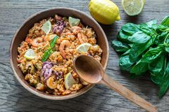 Seafood paella. Dish of seafood paella on the wooden table Royalty Free Stock Photo