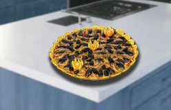 Seafood paella. On the kitchen counter Royalty Free Stock Photo