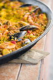 Seafood paella in pan. In an andalusian seafood restaurant royalty free stock photography