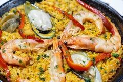 Seafood paella in the pan stock photo