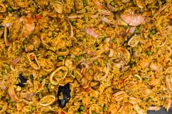 Seafood paella in a paella pan at a street food market. Seafood paella in a paella pan royalty free stock images