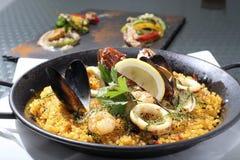 Seafood Paella. Sea food paella with sea grapes and shrimp and shellfish Royalty Free Stock Image