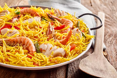 Seafood Paella Served in Metal Pan with Wood Spoon Royalty Free Stock Images