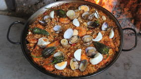 Seafood Paella  on a wood fire at home stock footage