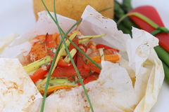 Seafood Papillote. Seafood in a parchment paper stock images