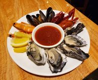 Seafood party in a plate stock images