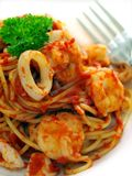 Seafood pasta. On a plate with fork Royalty Free Stock Image