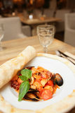 Seafood pasta cooked under pizza dough leaf Royalty Free Stock Photos