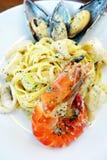 Seafood pasta dish, cream sauce stock images