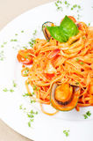Seafood pasta. With prawns, mussel and scallops on a white plate Stock Photo