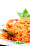 Seafood pasta. With prawns, mussel and scallops on a white plate Stock Image
