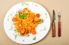 Seafood pasta. With prawns, mussel and scallops on a white plate Royalty Free Stock Image